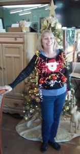The next day, we sold our first Ugly Christmas Sweater to a dear lady who volunteered to model it!  Looks amazing!!!