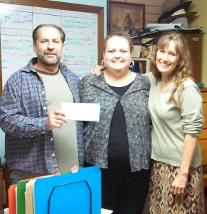 Pastor Joseph, Heidi & Desiree and the first grant to LTOM ever!