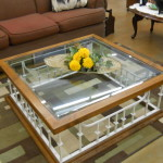 This stunning glass and white wrought iron table is $75